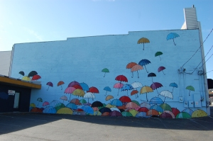 Mural at 220 Puyallup Ave. Lead artist: Chris Sharp. Artist team: Kate Cendejas, Yvette Simone, Janice Lee Warren.