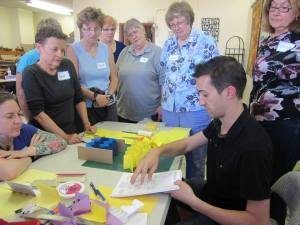 Book artist Kevin Steele teaching a dimensional book binding workshop for Puget Sound Book Artists. Photo courtesy of PSBA.