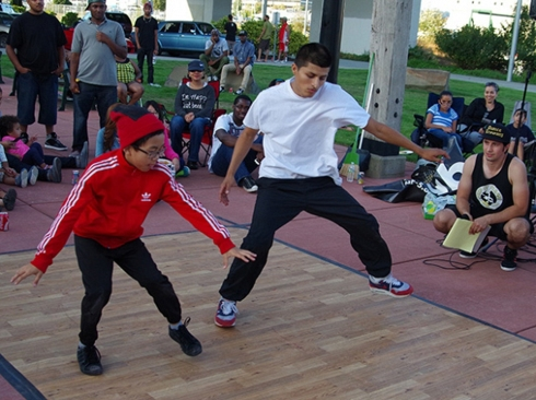 A duo does a dance routine during the final round of Fab-5's AfterLIFE breakdance battle