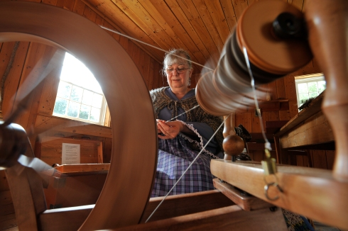 An artisan provides a spinning demonstration during Crafts of the Past. Photos By Russ Carmack.