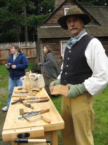 An artisan gives a woodworking demonstration during Crafts of the Past. Photo provided by Fort Nisqually Foundation.