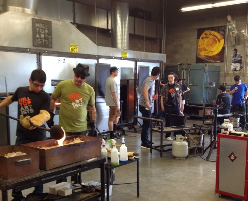 Artists hard at work in the Hilltop Artists hot shop at Jason Lee Middle School. Photo by Scott Ramsey.