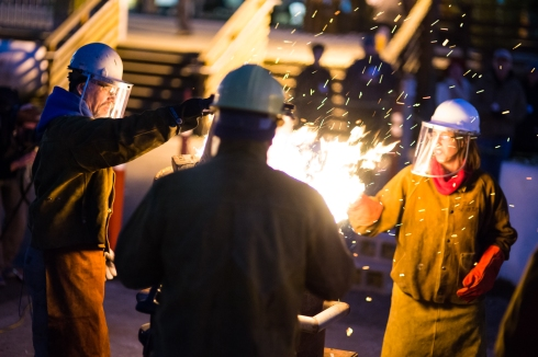 Tacoma Community College's sculpture program performs a live molten iron pour as part of Tacoma Arts Month in 2013.