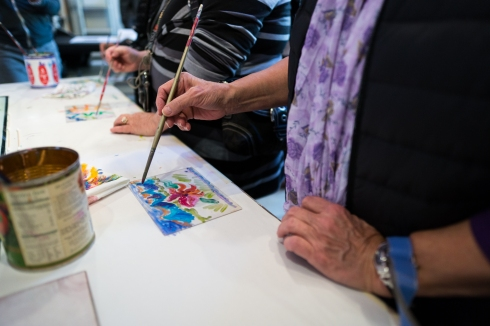 Studio visitors try their hand at a sample project during the Tacoma Studio Tour.