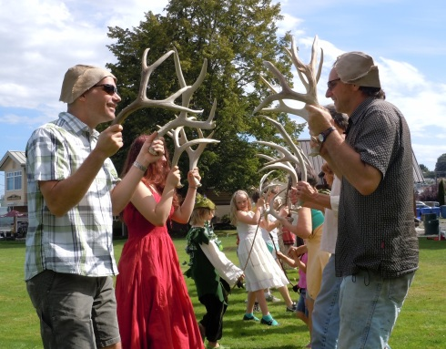 Community members participate in The Horn Dance, part of Puget Sound Revels' Bromliad event. Photo courtesy of Puget Sound Revels.