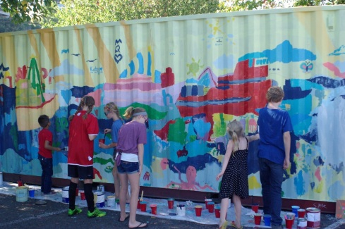2014 Tacoma Maritime Fest attendees add to the community mural on a shipping container.
