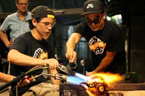 RJ Oki and Trent Quoicho blowing at the Museum of Glass as part of a collaboration with Team Chihuly.