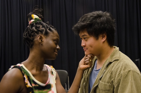"Akua Konadu as Naja counsels Richard Lee as Anon in ""Anon(ymous)"", Toy Boat Theatre at UW Tacoma. Photo by Peter Serko."