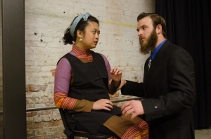 Jillian Lee as Nemasani is bullied by her employer, Yuri Mackus, played by Claymore MacTarnaghan. Photo by Peter Serko.