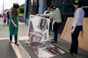 Revealing a steamroller print, created by Charles Wright Academy, at Wayzgoose. Photo by Aaron Locke.