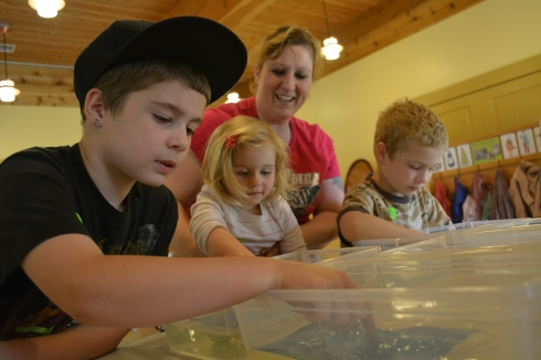 Families get hands-on at Crafts of the Past. Photo provided by Fort Nisqually Foundation.
