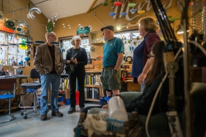 Randy Jones talks with visitors at his studio.