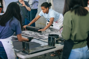 Arts Projects funding supports Tacoma Wayzgoose: Letterpress and Book Arts Festival. A student from Charles Wright inks a linoleum plate for Steamroller Printing.  Photo by Scott Haydon.
